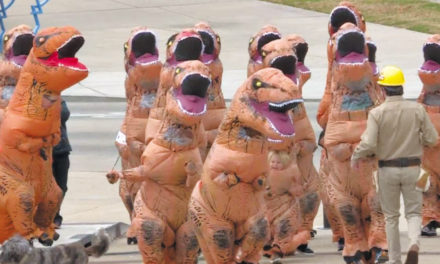 Dozens Dressed As T-Rex Descend On Public Square