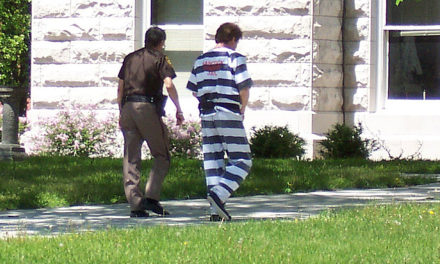 Hitchhiking Escapee Flags Down Officer, Goes Back To Jail
