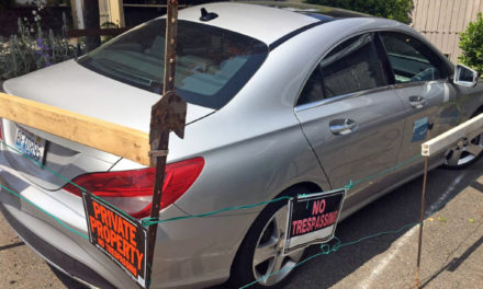 Man Builds Fence Around Car-Share Vehicle At Duplex
