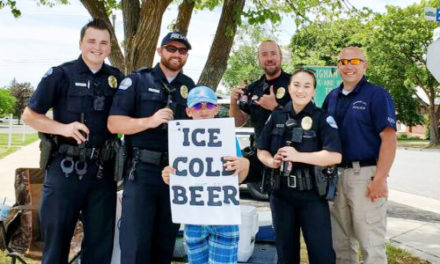 Young Boy Advertises Ice Cold Beer At Root Beer Stand