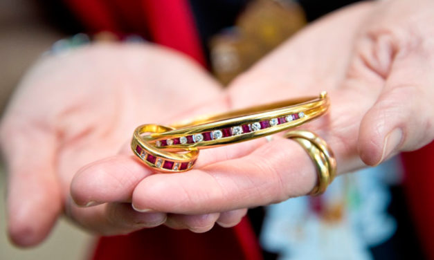 Tiffany & Co. Jewelry Dropped  In Red Salvation Army Kettle