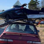 Wisconsin Trooper Stops Driver Hauling Snowmobile Atop Car